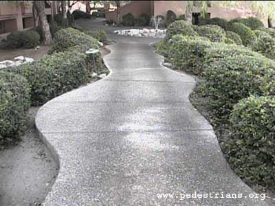 Photo - curved sidewalk design with central straight section.