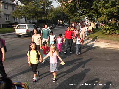 Photo - Students and parents walk to school on International Walk to School Day.